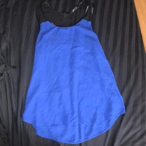 Bright royal blue tank top with black top straps